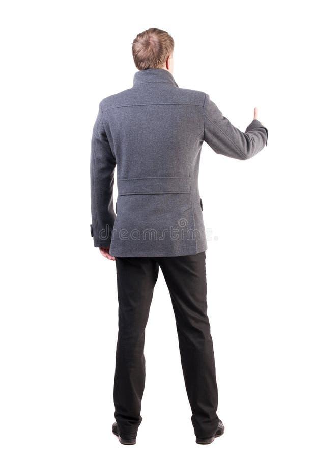 后面观点的商人显示赞许 免版税库存照片