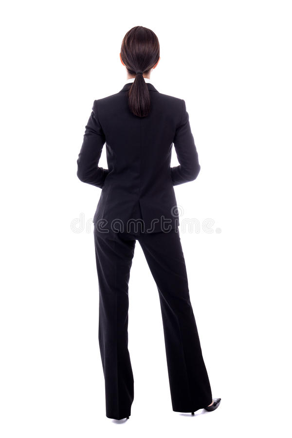 后面观点的在白色隔绝的黑衣服的女商人 图库摄影