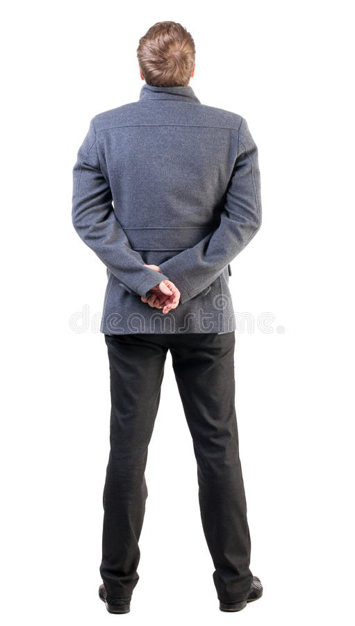 后面观点的外套的英俊的商人。 库存图片