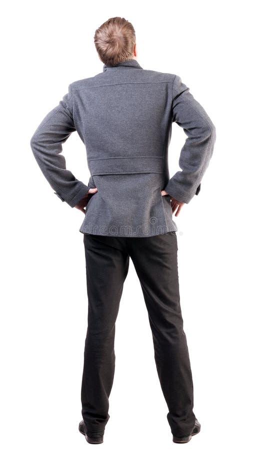 后面观点的外套的英俊的商人 库存照片