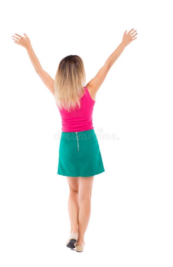 后面观点的女商人 举他的拳头在胜利标志 库存照片