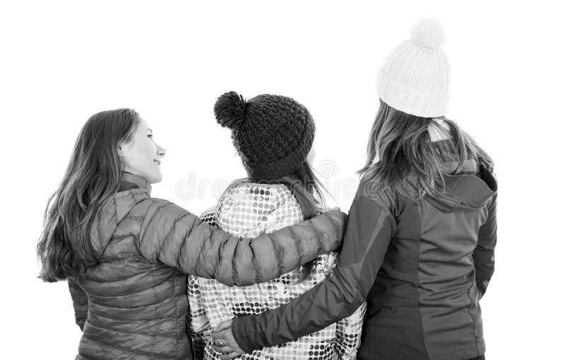后面观点的年轻姐妹 免版税库存照片