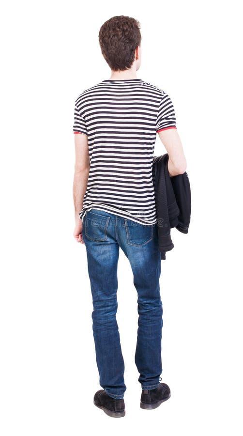 后面观点的牛仔裤的人 免版税库存照片