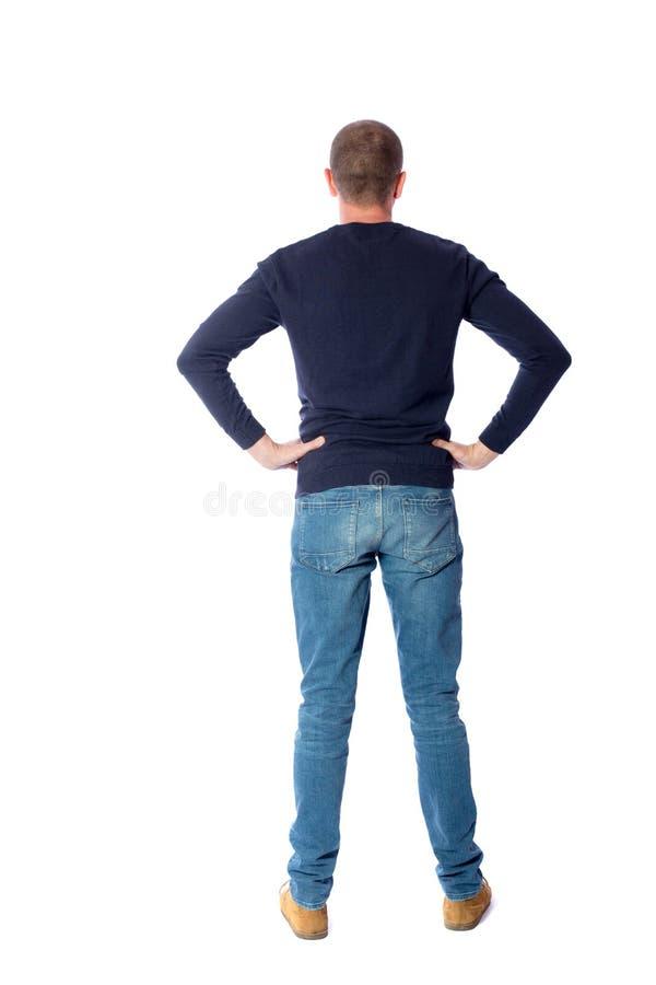 后面观点的牛仔裤的人 免版税库存图片