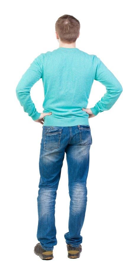 后面观点的牛仔裤的人 免版税图库摄影