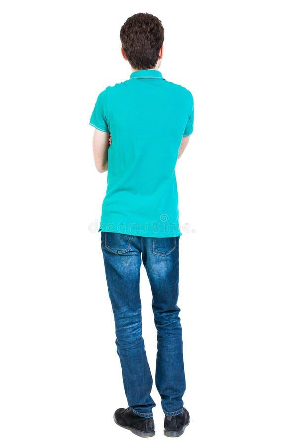 后面观点的牛仔裤的人 库存照片