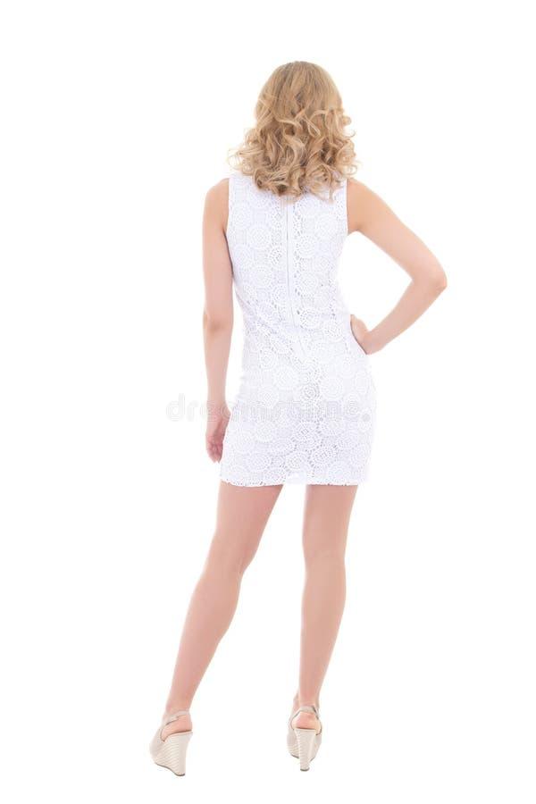 后面观点的白色礼服的妇女 免版税库存图片
