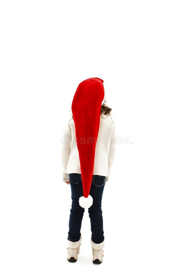 后面观点的红色圣诞老人帽子的小女孩,查寻 库存图片