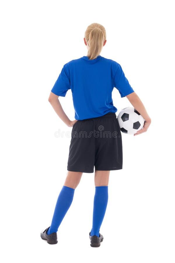 后面观点的蓝色制服的女性足球运动员有球isol的 库存图片