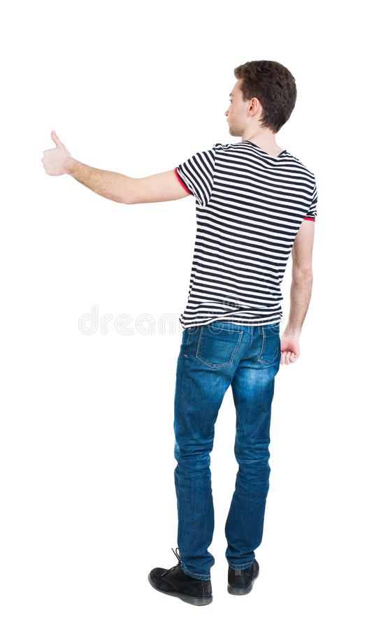 后面观点的衬衣的人显示赞许 图库摄影
