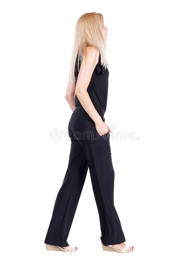 后面观点的走的妇女 免版税库存图片