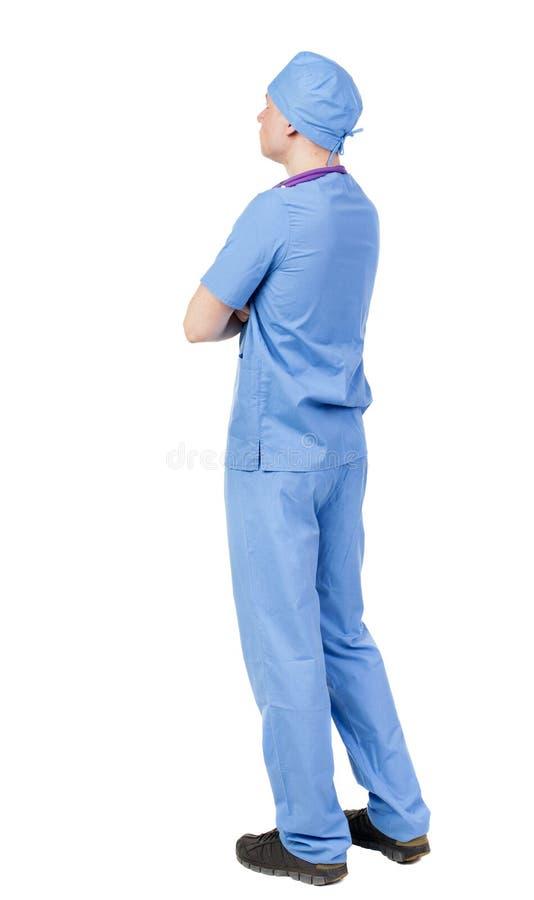 后面观点的长袍的医生 免版税库存照片