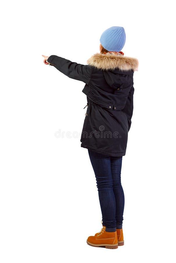 后面观点的附头巾皮外衣点的一名妇女他的手 免版税图库摄影