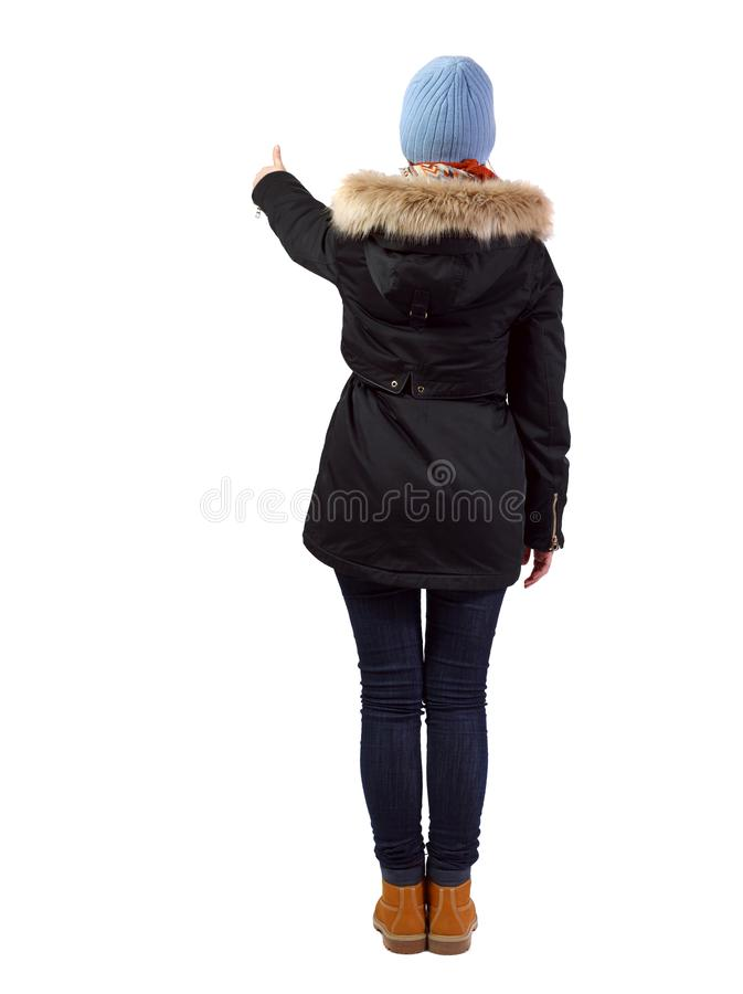 后面观点的附头巾皮外衣赞许的妇女 免版税库存图片