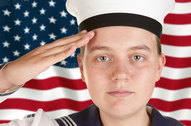 向我们致敬的标志前水手新 免版税库存图片