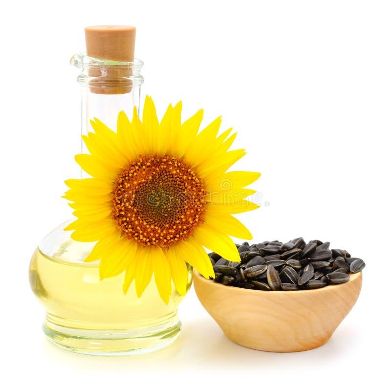 向日葵油、种子和花 免版税库存图片