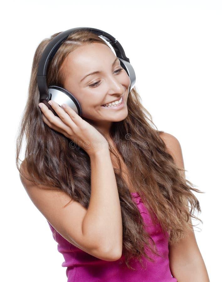 听到音乐的女孩 免版税库存图片