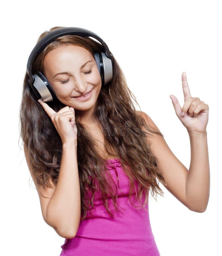 听到音乐的女孩 库存照片