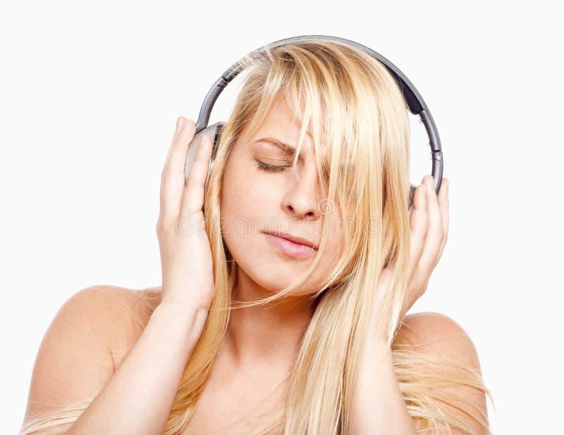听到音乐的女孩 库存图片