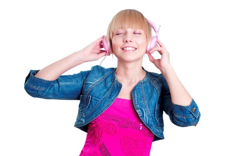 听到音乐的女孩 免版税库存照片
