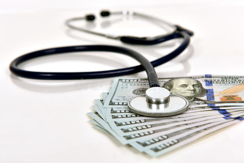 听诊器和货币 免版税库存照片