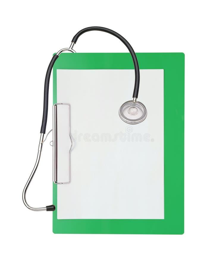 听诊器和绿色剪贴板 库存图片