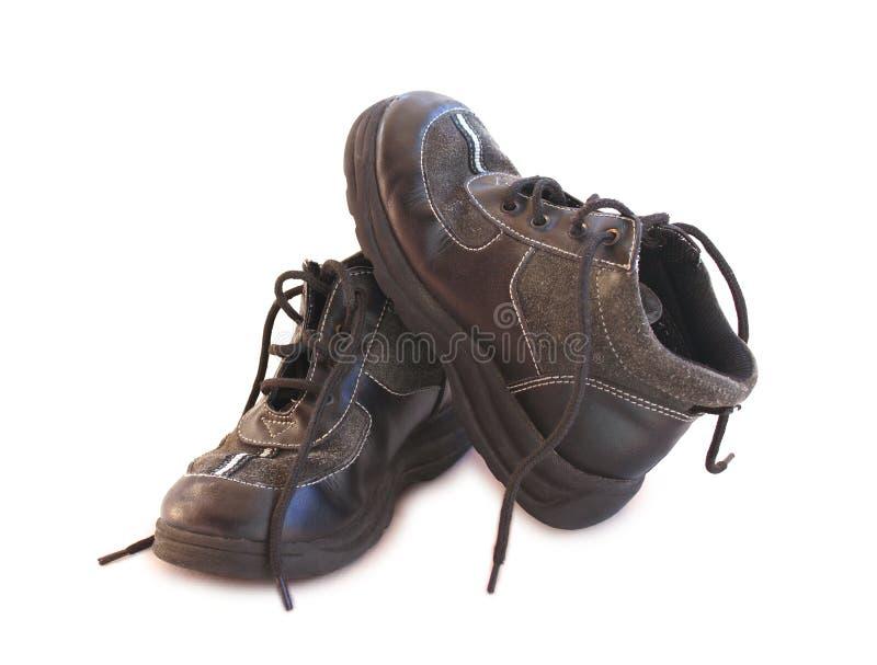 启动男孩被取消的鞋带老 库存照片