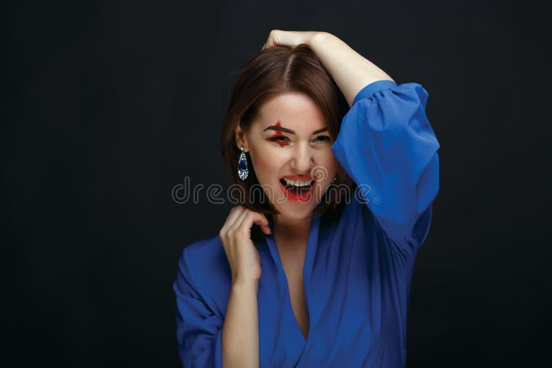 吸血鬼万圣夜妇女画象 免版税图库摄影