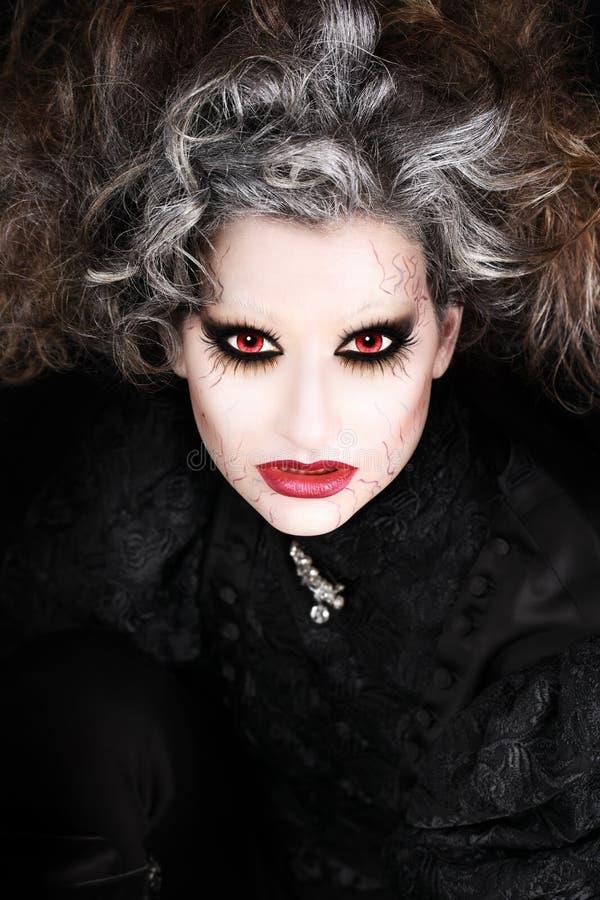 吸血鬼妇女,万圣夜组成 免版税库存照片