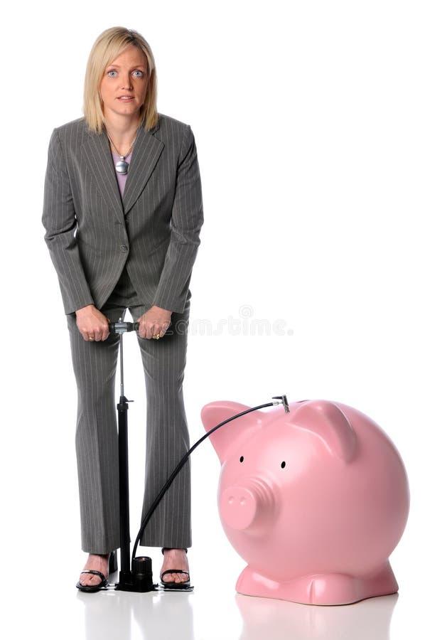 吹女实业家贪心的银行 免版税库存照片