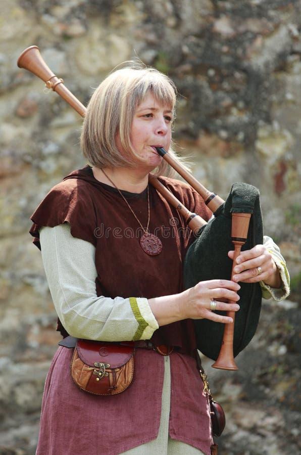吹风笛者女性 库存照片