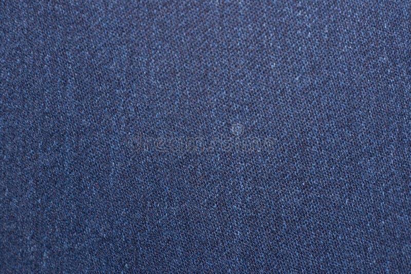 呈杂色的织品牛仔布样式罚款材料软的物质蓝色口气 免版税库存图片