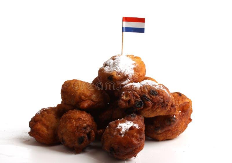 告诉的油炸圈饼荷兰语oliebollen 库存图片