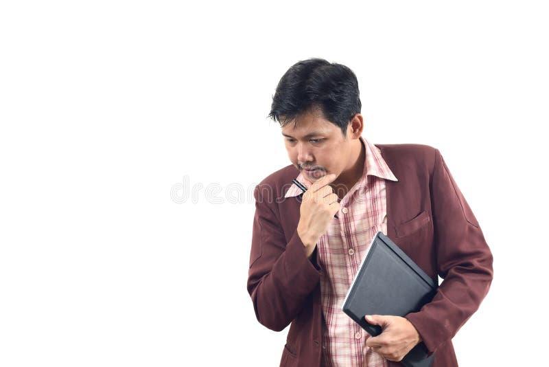 周道和拿着在手上的亚洲商人笔记本 免版税库存图片