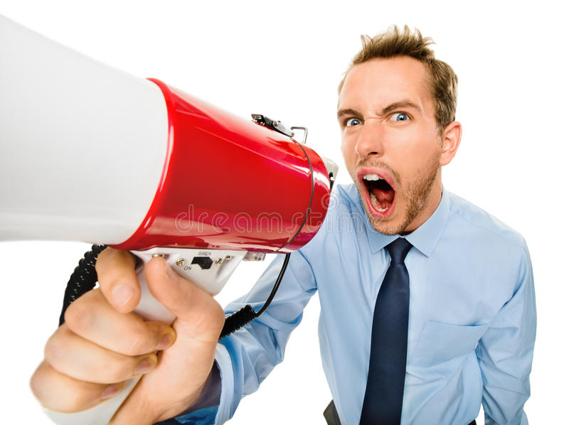 呼喊与在白色backgrou的扩音机的积极的商人 库存照片