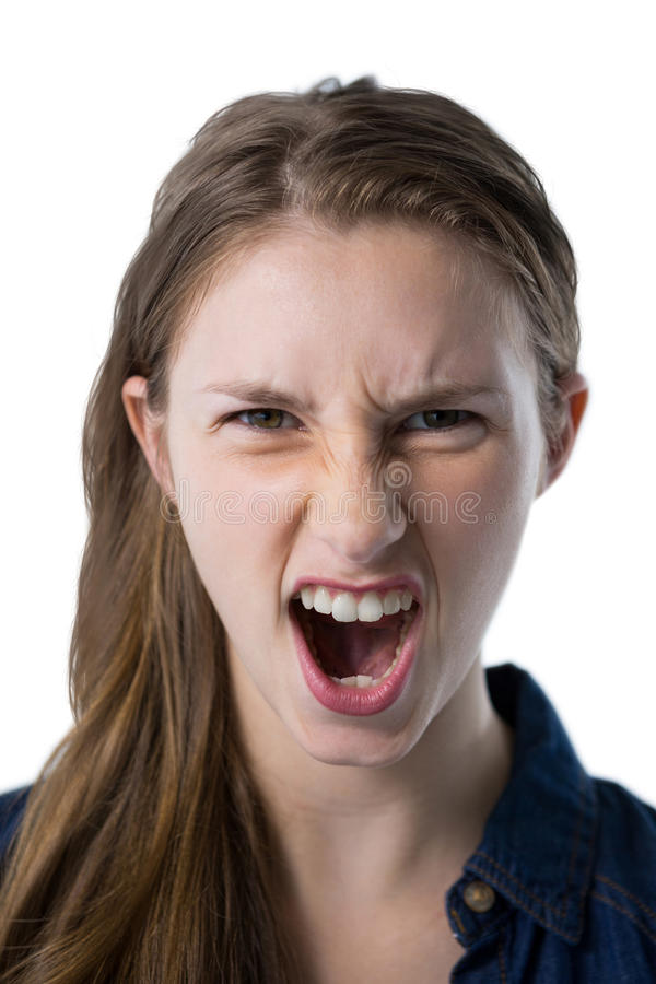 呼喊反对白色背景的十几岁的女孩 免版税库存照片