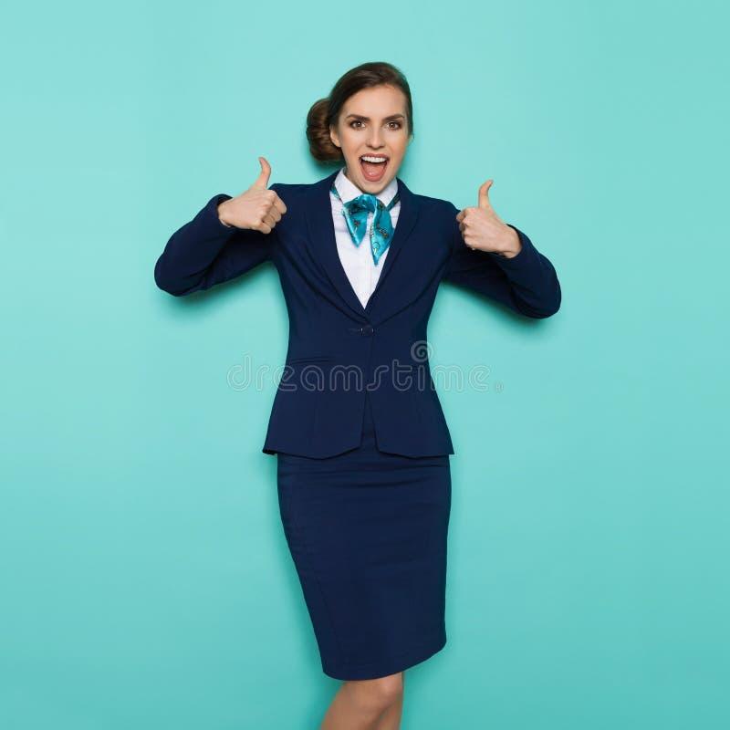 呼喊的空中小姐显示赞许 免版税库存照片