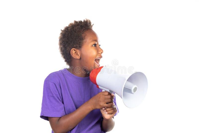 呼喊通过扩音机的小男孩 库存照片
