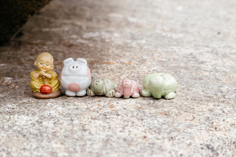 和尚、猪和乌龟微型在韩国 免版税库存图片