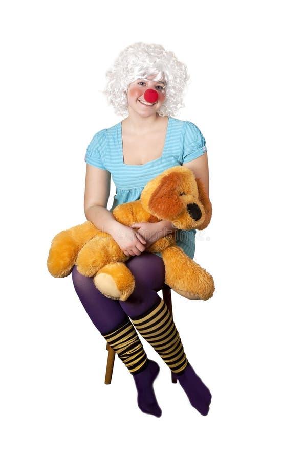 有一个软的玩具的女孩 免版税库存图片