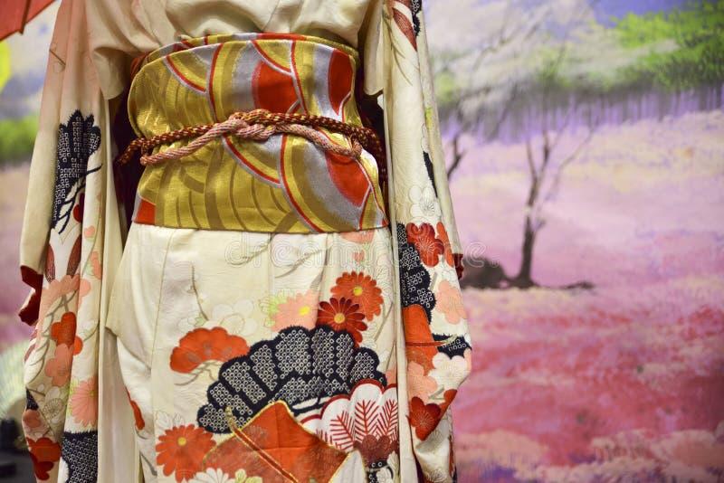 和服 妇女的传统日本人礼服有装饰的 图库摄影