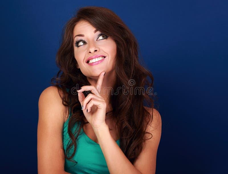 和看想出在empt的被集中的乐趣做鬼脸的妇女 库存照片