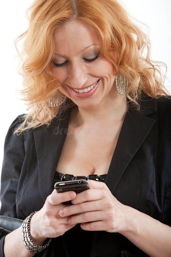 年轻和美丽的白肤金发的白种人女实业家 免版税库存图片