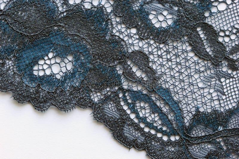 黑和蓝色花系带物质纹理宏指令射击 免版税库存照片