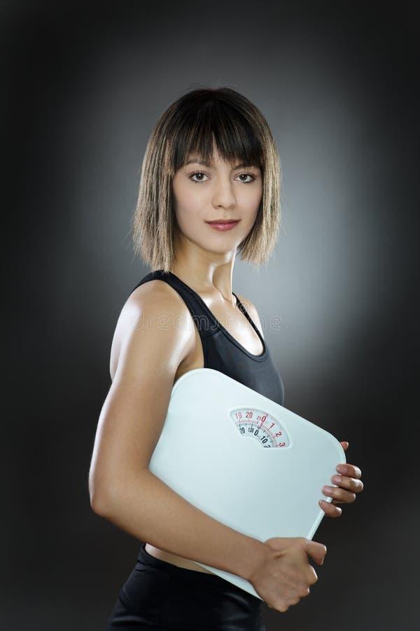 年轻和适合的妇女 免版税库存照片