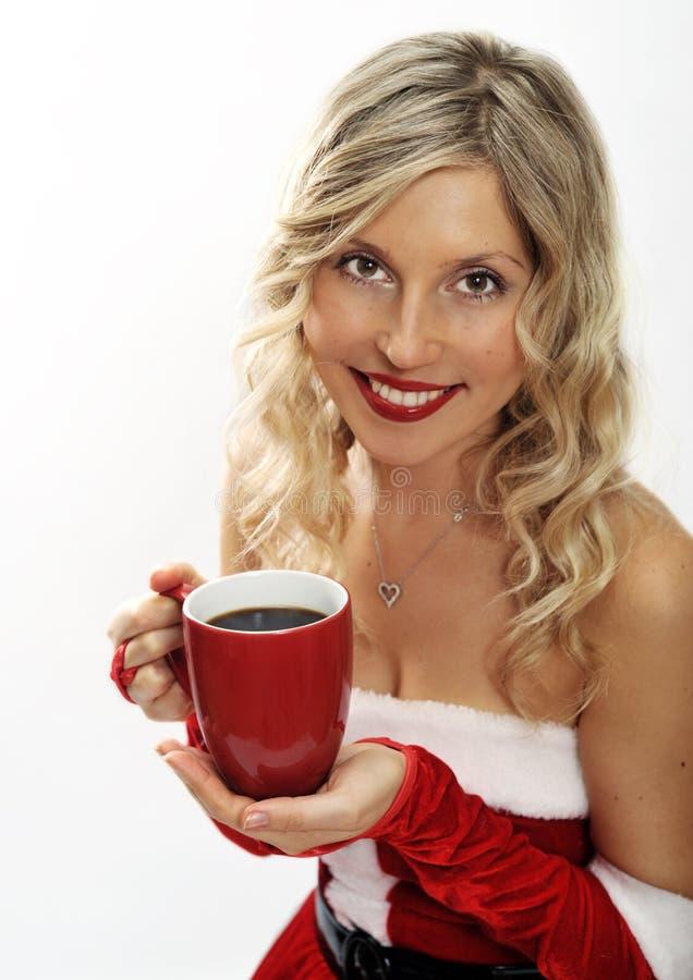 咖啡喝女孩针圣诞老人  免版税库存图片
