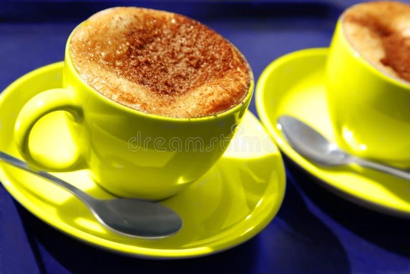 咖啡杯二黄色 免版税库存图片
