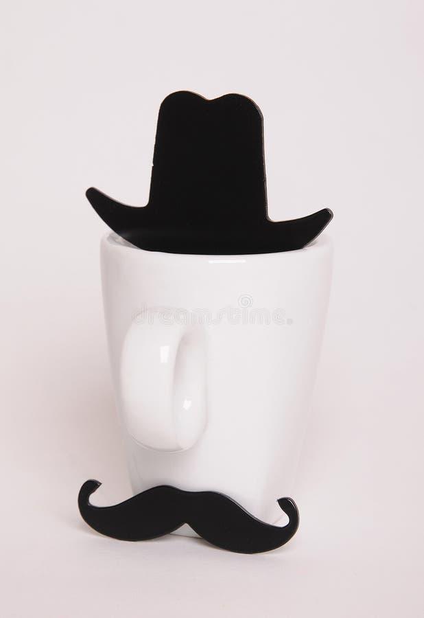 咖啡杯供以人员图象 行家样式,髭,帽子 库存照片