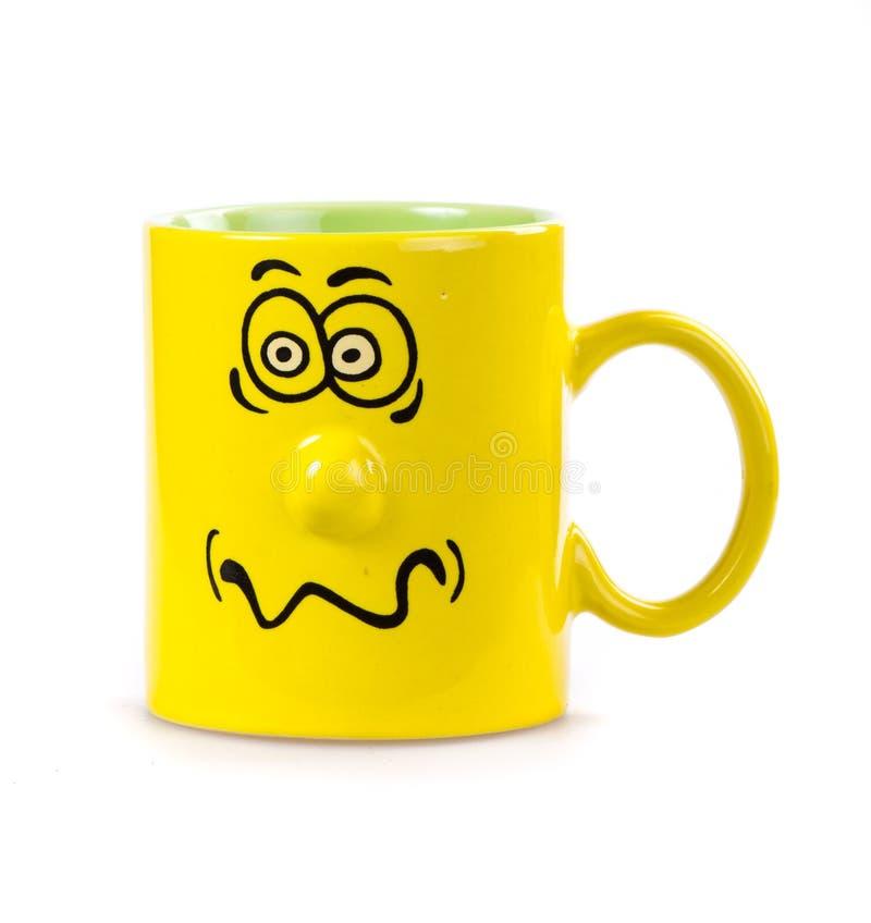 咖啡杯咧着嘴 库存图片