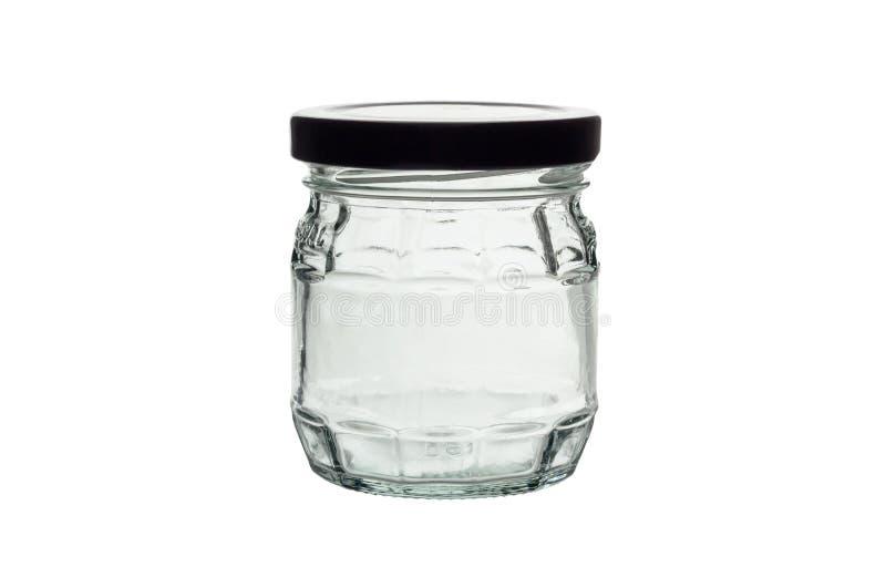 咖啡玉米玻璃瓶子溢出的表 库存图片